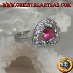 Silver ring in the shape of a horizontal heart with a synthetic round ruby set surrounded by zircons