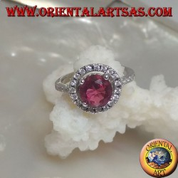 Silver ring with round synthetic ruby set surrounded by zircons and extension on the sides
