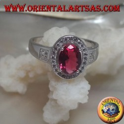 Silver ring with oval synthetic ruby set surrounded by cubic zirconia and square on the sides