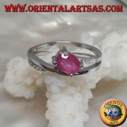 Silver ring with natural oval transverse ruby set on two threads intertwined with zircons