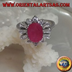 Silver ring with oval natural ruby surrounded by triple round zircons and alternating trapezoids