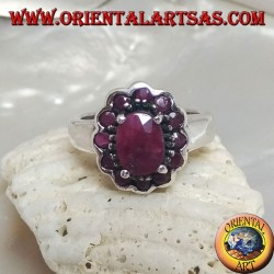Silver ring with oval natural ruby set surrounded by small round rubies