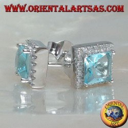 Silver earrings with natural blue topaz set in a square surrounded by zircons