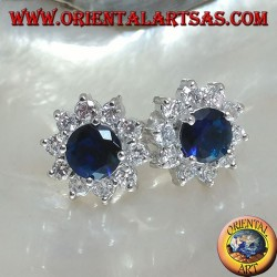 Silver lobe earrings with round synthetic sapphire set surrounded by zircons