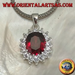 Silver pendant with faceted oval garnet set surrounded by round zircons