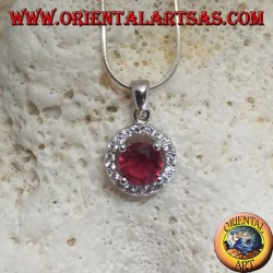 Silver pendant with round synthetic ruby set surrounded by round zircons