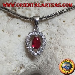 Silver pendant with synthetic teardrop ruby set on an inverted teardrop zircon setting