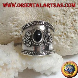Wide band silver ring with oval onyx and spiral triskéll on the sides, Bali