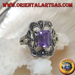 Silver ring with rectangular amethyst colored zircon surrounded by a curved rectangle of marcasite
