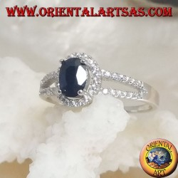Silver ring with oval synthetic sapphire set surrounded by zircons and two lateral lines
