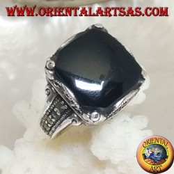 Silver ring with square onyx cabochon in a wavy frame and marcasite around and on the sides