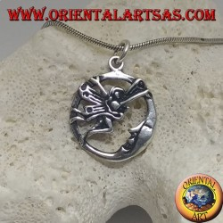 Silver pendant fairy flying in front of the moon in the circle