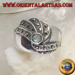 Silver ring with round aquamarine and concentric spiral marcasite rows