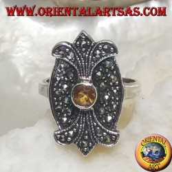 Silver ring with round yellow topaz on oval shield with double mirror lily studded with marcasite