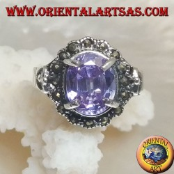 Silver ring with oval amethyst colored zircon set surrounded by marcasite and openwork on the sides