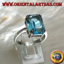 Silver ring with rectangular blue topaz set with a claw setting