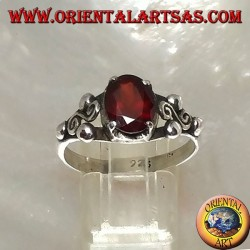 Silver ring with oval faceted garnet and Greek garnet between three balls on the sides