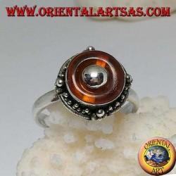 Bague en argent avec disque d'ambre naturel et boule centrale