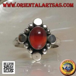 Silver ring with oval cabochon carnelian surrounded by alternating studs and balls
