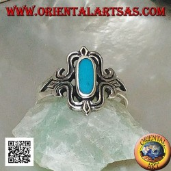 Silver ring with oval turquoise elongated in a stylized rectangle
