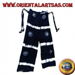 Long blue unisex pantapareo with white designs of horizontal bands and stylized suns