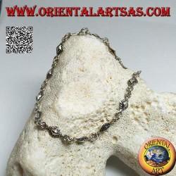 Bracciale in argento morbido a piastrine romboidali con contorni puntinati