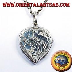 Photo pendentif porte-coeur incrusté d'argent