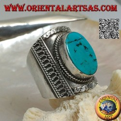 Wide band silver ring with flat Tibetan antique oval turquoise on the rise and Nepalese decorations