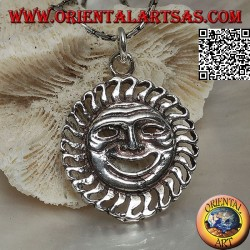 Silver pendant in the shape of the sun with a satirical / ironic face