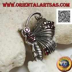 Spilla in argento a forma di farfalla di profilo tempestata di marcassite e granati