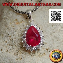 Silver pendant with drop-shaped ruby-colored zircon surrounded by white zircons