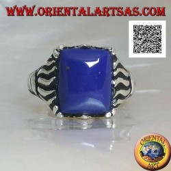 Silver ring with rectangular sodalite set in a cabochon with lines engraved on the sides