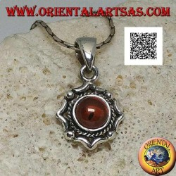 Silver pendant with round natural amber on an eight-pointed stylized star