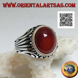 Silver ring with oval cabochon carnelian surrounded by dots and stripes engraved on the sides