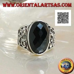 Silver ring with oval faceted onyx and openwork decoration on the sides