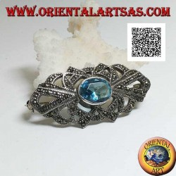 Silver brooch with oval blue topaz and openwork decoration studded with marcasite