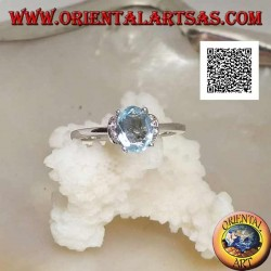 Silver ring with oval natural blue topaz set and row of vertical zircons on the sides