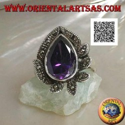 Silver ring with large drop amethyst colored zircon surrounded by leaves studded with marcasite