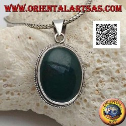 Silver pendant with green hematite or oval blood stone surrounded by a thin weave