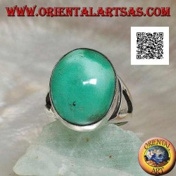 Silver ring with natural Tibetan antique oval turquoise on a smooth side frame