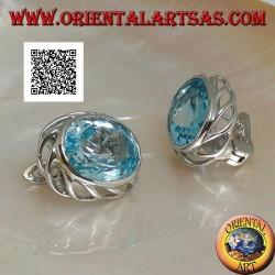 Silver lobe earrings with blue oval topaz on with openwork weave on the sides and lever closure