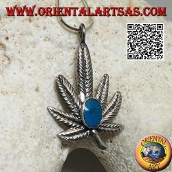 Silver pendant in the shape of a marijuana leaf with central oval turquoise