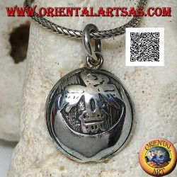 Round silver medal pendant with condor (sacred bird of the Inca civilization) on the moon