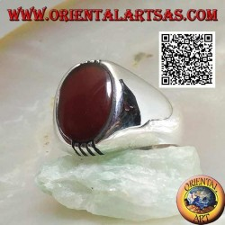 Silver ring with oval carnelian on a smooth frame and 4 rows above and below
