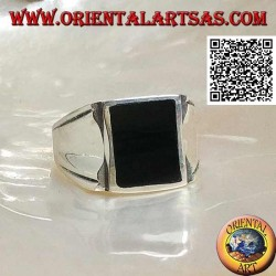 Silver ring with rectangular onyx on a smooth frame with central hollow on the sides
