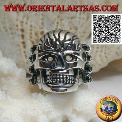 Silver ring, large skull with carved front supported by 4 bones on the side