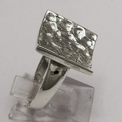 Silver ring, concave square and hammer