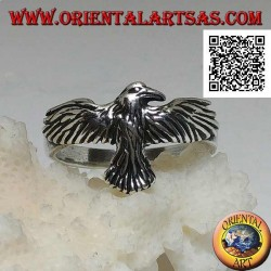 Silver ring with phoenix with spread and spread wings in flight