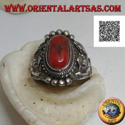 Silver ring with ancient Tibetan coral on Nepalese setting with Garuḍa (progenitor god of birds) on the sides