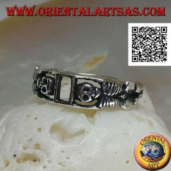 Silver ring composed of two stretched skeletons joined by the arms